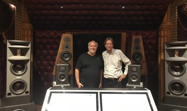 Award-winning producer, engineer, and mixer Jay Baumgardner stands with Allen Sides at NRG's Studio C with their new OWA HR3.5 monitors and S18A subs.