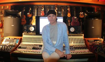Steve Vai's Studio Guitar king Steve Vai in his private studio with OWA HR3 monitors.