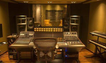 Gaira Musica Local Studios Studio for Latino superstar Carlos Vives in Bogota, Colombia, created by Malvicino Design Group. A pair of Ocean Way Audio HR3.5 studio monitor speakers are featured.